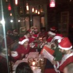 No one told me it was National Santa Day! The pic is blurry because I ran into a restaurant and snuck this photo... Ha! http://t.co/8UOFeJbD