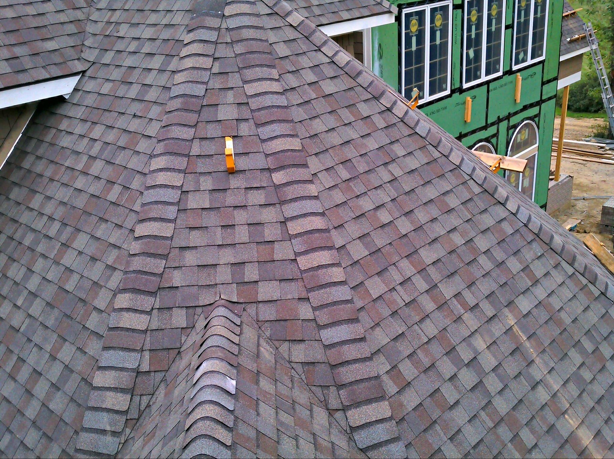 On the roof. Installing CertainTeed Landmark Weathered Wood shingles. Looks like it may rain. http://t.co/El2mdHmS