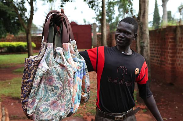 New Digs from Uganda. Check out the proud creators of the new EPOH Bags. #handmade #uganda #EPOH