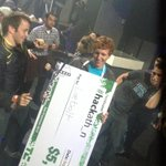 Hackathon winner LiveBolt dancing with big check #TCDisrupt