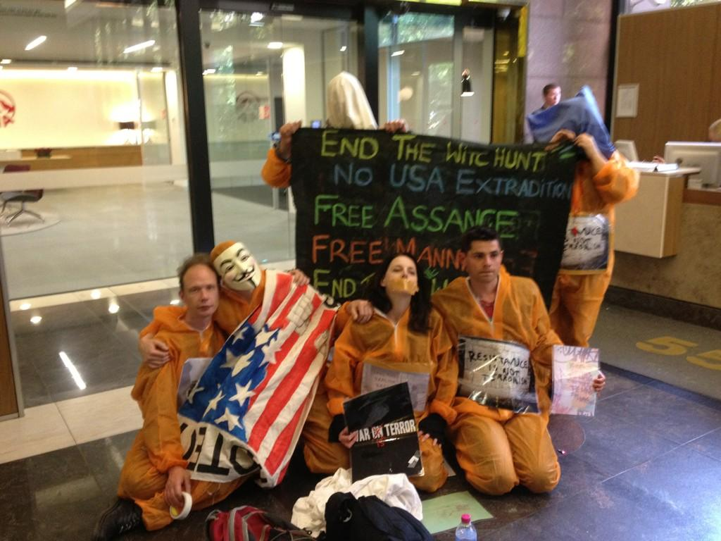 #USA consulate sit in #Gitmo suits and ready to resist Free #Assange Free #Manning #Wikileaks #Gitmo #torture #drones http://t.co/5Ss9NbL2