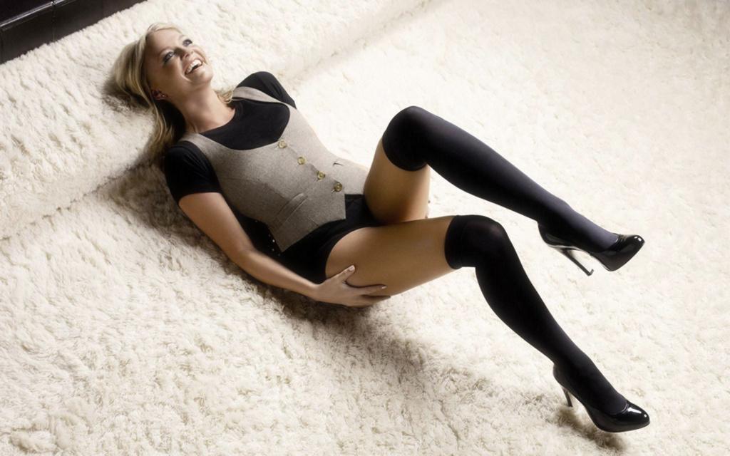 Emma Bunton laying on a white fluffy carpet in black sexy knee high socks - http://t.co/OeYegEua