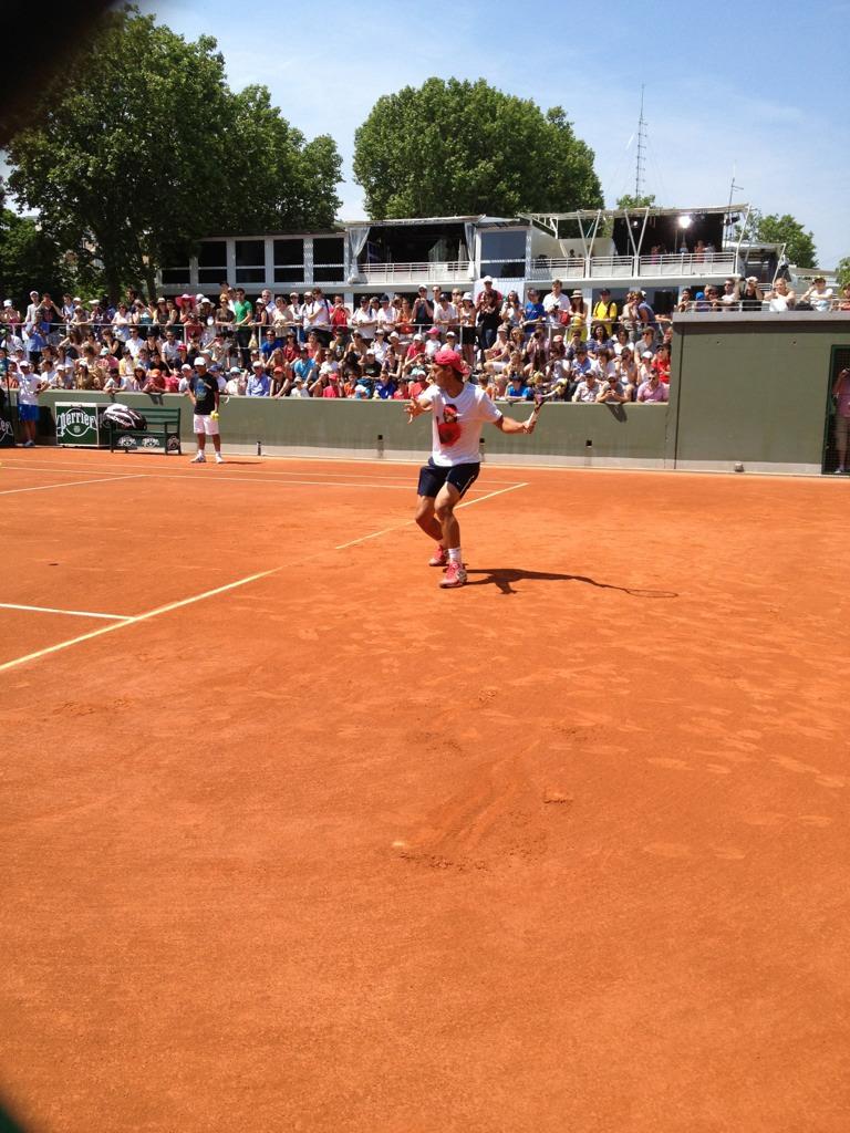 haha Rafa in his Rafa shirt. Lol #nadal '@natalieHOHO: Forehand. #Nadal http://t.co/8IfWMRXK'