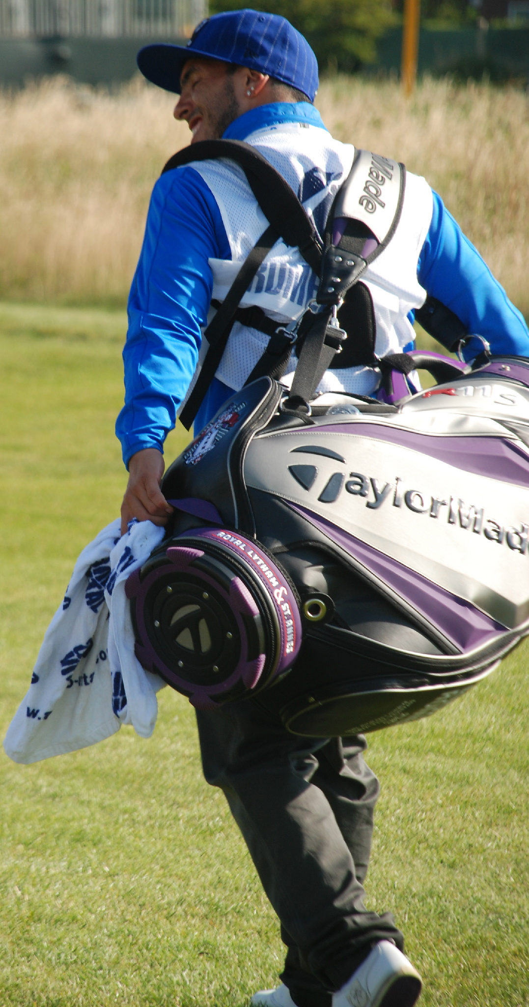 The rumours are true! Carlos Tevez is caddying for Andres Romero. #TheOpen http://t.co/VDLFZnmL