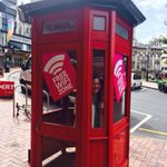 My #FCC lawyer wife Amy Nathan celebrating passage of #NetNeutrality in phone booth turned wifi hotspot in Dunedin NZ http://t.co/plwzEvefHu