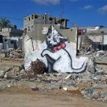 Banksy creates street art in Gaza criticising worlds largest open-air prison http://t.co/H9rM4ZvkfR http://t.co/fdW1a6EJrZ
