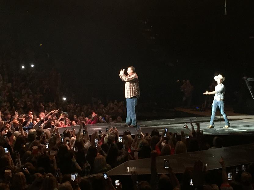 Coach Bret Bielema in plaid and cowboy boots calling the Hogs on stage with Justin Moore. http://t.co/8SbfCuigu6