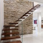 Staircase turns a corner at a large stone chimney: http://t.co/S8k8wgmCbX http://t.co/BvMYK9FO2A #architecture #design