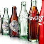 - @CocaCola    Cien años de una botella tan seductora como influyente - http://t.co/kLeXSp5k0f http://t.co/Q26yFsqBeq