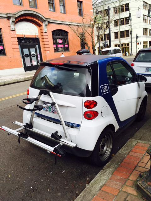 Spotted near our office: 1 of the @car2goPortland smart cars newly-outfitted w/ dual bike racks!!! http://t.co/O0viTWsuTI