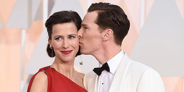 So sweet! Benedict Cumberbatch smooches his pregnant wife on the Oscars red carpet