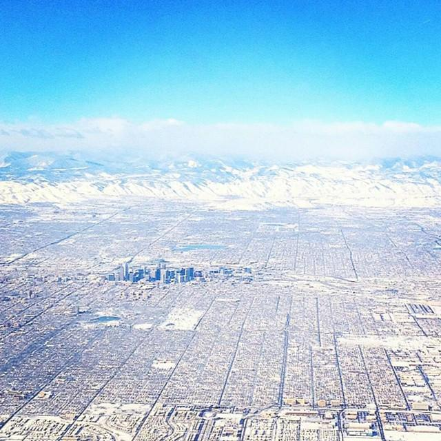 What a stunning view! Snowy, sunny Denver from the sky captured by Instagram fan (@)shuttershelly. #PhotoFriday http://t.co/qEMqEvDj60