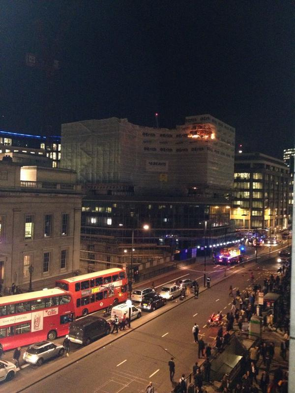 Big big fire at #LondonBridge guys, debris falling on pavement, road closed, stay safe! http://t.co/mBjzscCkCJ http://t.co/bdAcKENcFt