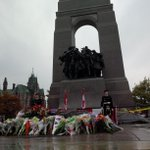 With respect & peacefully, Canadians remember W.O. Vincent & Cpl. Cirillo at the National War Memorial. #LestWeForget http://t.co/OZMjZOVG2D