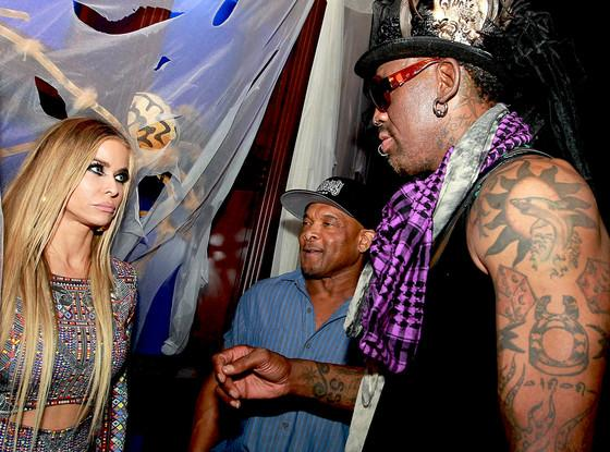 Carmen Electra's face when she runs into ex Dennis Rodman... Ouch!
