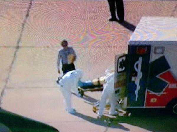 So... as the patient is transferred... what's up with the dude with the clipboard? Oh, and NO PROTECTIVE GEAR!?! http://t.co/AjOHhzvSUX