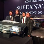 200th episode party. Believe it or not, what we are standing behind is a car-shaped chocolate cake. http://t.co/D3g7kPfETY