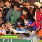 Chairman Imran Khan cutting the Diwali Cake with everyone on #PTI4InterFaithHarmony Day at #AzadiSquare. http://t.co/VcFkydj0Iv