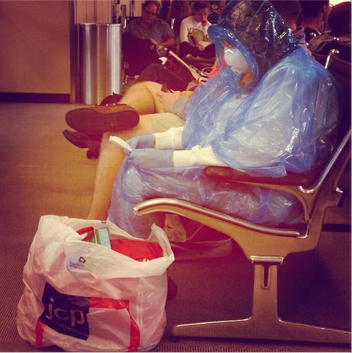 I'm being v.careful to not mention EBOLA in the airport - but this woman is taking no chances, and yes this is real http://t.co/xnJybJy63L