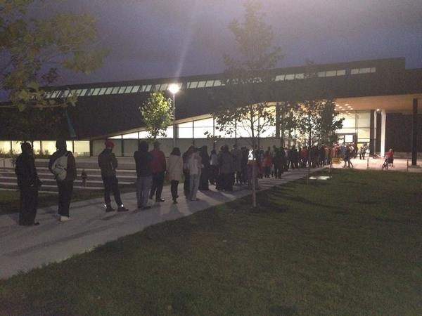 Charlsie Agro (@CBCharlsie): Regent Park you're beautiful. Check out this turn out. People lined up for #TOvotes #sl http://t.co/RgjPOt1YxF