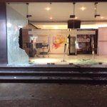Chennai Satyam theater glass walls are damaged by unknown people. They thru fire balls all inside the theater. Oooooo http://t.co/mYd3ZhmzNK