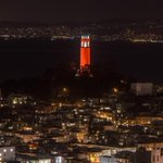 Coit Tower in San Francisco lit in orange for the @SFGiants. http://t.co/OTa1sVvqHh @MLB #WorldSeries http://t.co/yuF0x2czif