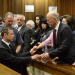 A powerful image of #OscarPistorius walking down to the holding cells and starting his prison sentence. http://t.co/tCLSdwl0AJ