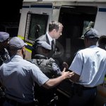 #OscarPistorius leaves in a police van on his way to prison #OscarTrial @GS_Images http://t.co/qT9vSYbv11