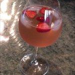 This is for @mrsgnation white wine,ginger lemonade cranberry shot of cognac an splash of Pellegrino couple strawberry