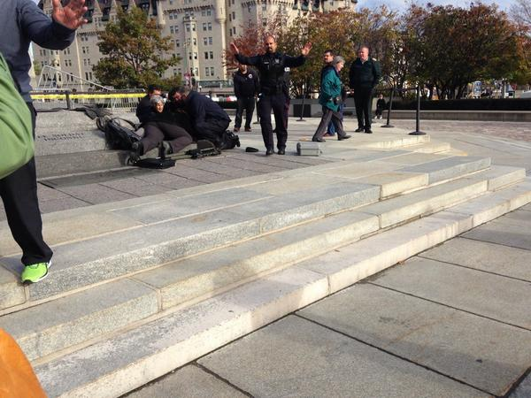 BREAKING paramedics working on man lying next to war memorial #cdnpoli http://t.co/eWkJALMoxF