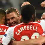 RT @tomgunner14: Lukas Podolski is mobbed by his teammates after his late winner. #Arsenal http://t.co/eBDMjQOPRX