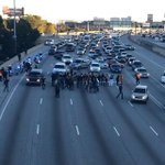 #FergusonOctober Protesters in Atlanta hold traffic up on I-85 and I-75! http://t.co/p2kOHSfL7D #Ferguson #MikeBrown http://t.co/ZsuYjyJkVw
