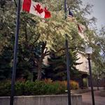 Rexall Place flags lowered in memory of Cpl. Nathan Cirillo and all those affected by todays shooting. #CanadaStrong http://t.co/v2BoLTWH6r