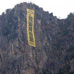 "RT @alexhofford: Umbrella banner now hanging off Hong Kongs iconic Lion Rock! Says ""We Want Universal Suffrage!"" #UmbrellaMovement http://t.co/rALk40TgTc"