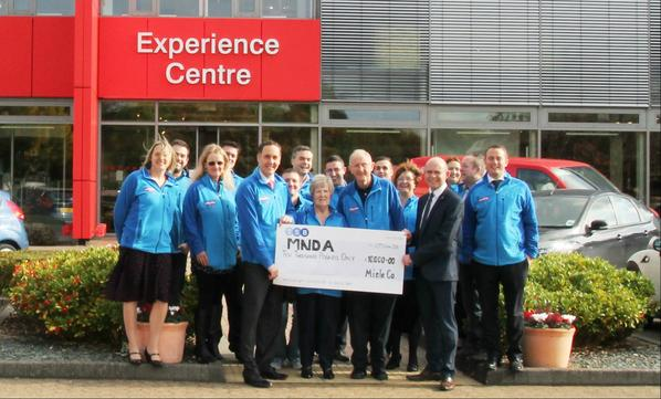 Miele 3 Peaks Team presenting @mndassoc with a cheque for £10,000  - Well done team Miele #MNDA http://t.co/QWpdS8JMMe