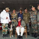 2/2: Pic1-Modi with a Swiss Mountain dog. Pic 2-Modi having tea (in steel glass) wid jawans. Great PM. #ModiInSiachen http://t.co/KWqL3tswSD