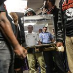 RT @chriskingstl: #Ferguson protestors wield Michael Brown mirrored coffin at STL County Police HQ protest @LBPhoto1 http://t.co/EUezBu3gBF
