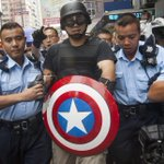 RT @alexhofford: Captain America arrested in Mong Kok #OccupyCentral #OccuoyMongKok #UmbrellaMovement http://t.co/PWAmL01skO ht @byAlanWong