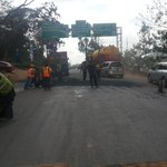 Kempiski pothole being fixed now @Ma3Route http://t.co/qvvkMKRrSX