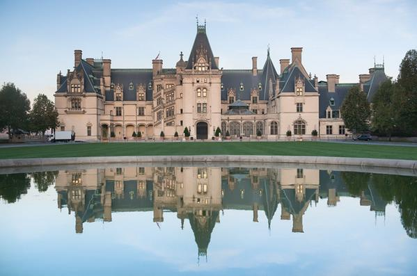 The morning calm yields a near-perfect reflection over the front lawn. #biltmore #photography http://t.co/upRs68Ag5c