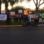 RT @AshleyYore: Protestors at the Governor Rick Scott appearance this morning. http://t.co/YeD9qee5fe