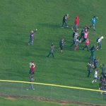 Scene from Skyking as students run from Marysville-Pilchuck High School - after reports of students shot in cafeteria http://t.co/SEvv4mZy81