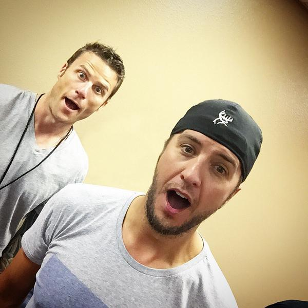 The moment @lukebryan figured out The Selfie Stick has a button on the handle. Mind. Blown. And now it's his. http://t.co/evz54cjrKh