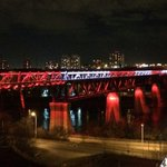 High Level Bridge is red & white again tonight to honour soldiers killed earlier this week http://t.co/0oBBcF2ueQ http://t.co/vbckiBEnrq