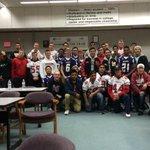 Oak Harbor takes team pic w/ Marysville Pilchuck HS football squad. Rivals no more http://t.co/GyTsdCgk0r