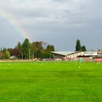 Sunshine and a rainbow over Marysville-Pilchuck HS after a day of unspeakable violence. A much needed sign of hope. http://t.co/t0XLDh9Dlz