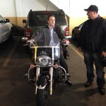 Cuomo pauses to examine a motorcycle after wrapping up his rally in Queens http://t.co/0Da0ce4H54