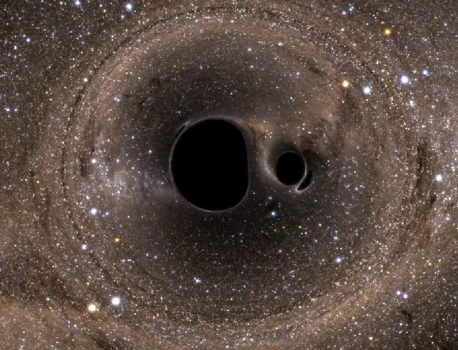 Fascinante recreación: dos agujeros negros giran, curvan el espacio-tiempo, y se funden. http://t.co/abJJ7PZNta http://t.co/xc346QnlyM