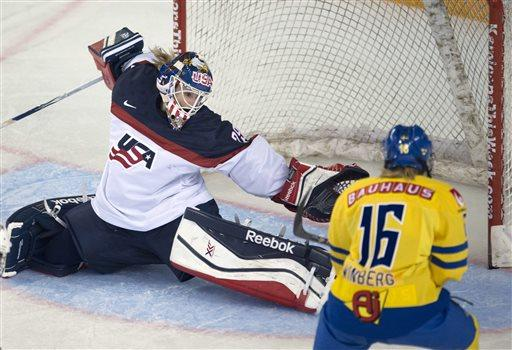 GAME PHOTO: @BrianneMcL made 11 saves for @usahockey to beat Sweden 3-0. Photo Credit: AP http://t.co/WiEzo5bS1n