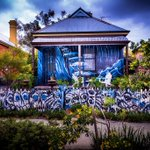 Brilliantly spooky looking house on Chelmsford Rd in #MtLawley. Happy #Halloween everyone! #perth #skulls #streetart http://t.co/zqJDH0QQYY